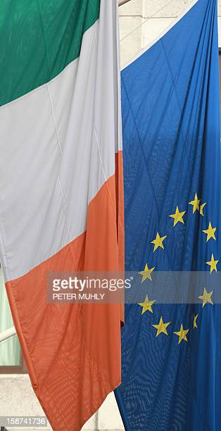 The Irish and European Union flags hang in Dublin Ireland on December 18 2012 ahead of Ireland's assumption of the rotating presidency of the...