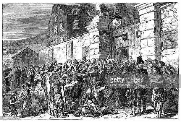 The Irish Famine 18451849 Starving peasants at a workhouse gate Illustration from The life and times of Queen Victoria by Robert Wilson