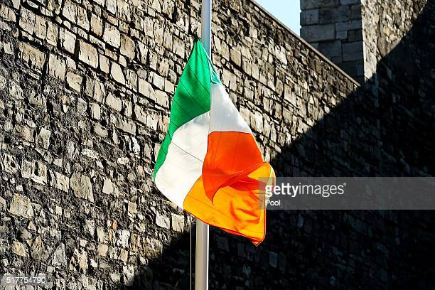The Irish Flag flies at the Easter Sunday Wreathlaying ceremony on the site where the 1916 leaders were executed at the Breakers Yard in Kilmanham...