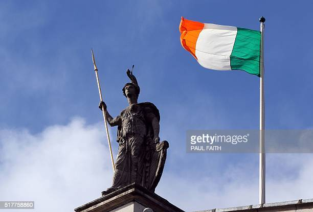 The Irish flag flies atop the General Post Office the scene of the 1916 Easter Rising in Dublin on March 27 2016 during a programme of commemorative...