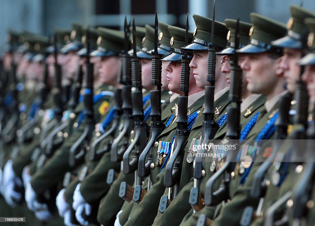 The Irish Guard of Honour stand at attention during a flag-raising ceremony at Dublin Castle in Dublin, Ireland on December 31, 2012 ahead of Ireland's assumption of the rotating presidency of the European Union on Jauary 1, 2013. AFP PHOTO/ PETER MUHLY
