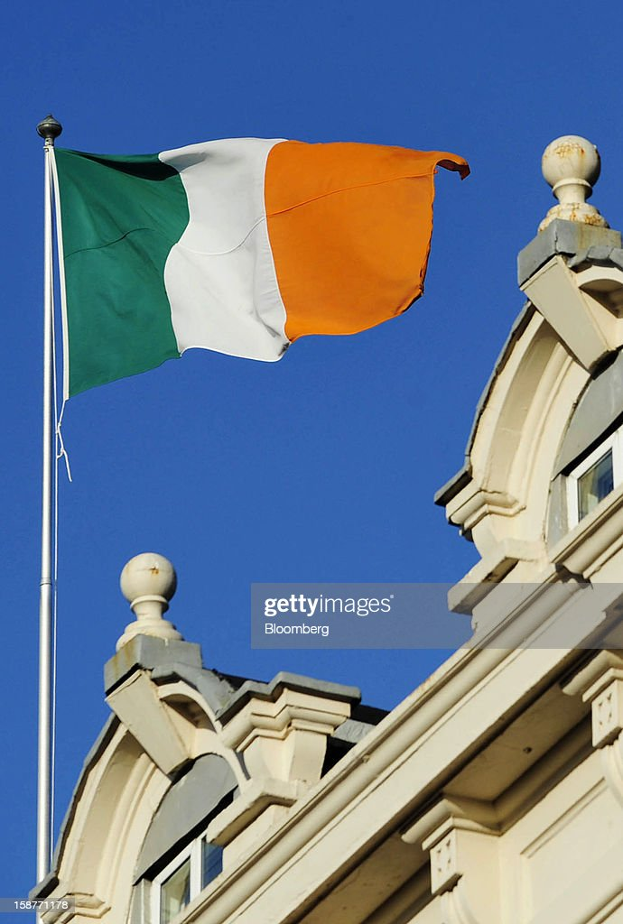 The Irish national flag flies from a flagpole above a building in Dublin, Ireland, on Thursday, Dec. 27, 2012. Ireland will take over the EU presidency in January as the euro-area wrestles with putting the European Central Bank in charge of lenders within the currency union and other participating nations. Photographer: Aidan Crawley/Bloomberg via Getty Images