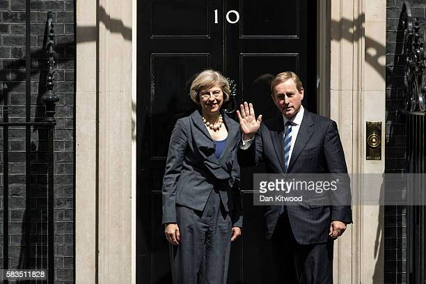 The Irish Taoiseach Enda Kerry is greeted by British Prime Minister Theresa May on the steps of 10 Downing Street on July 26 2016 in London England...