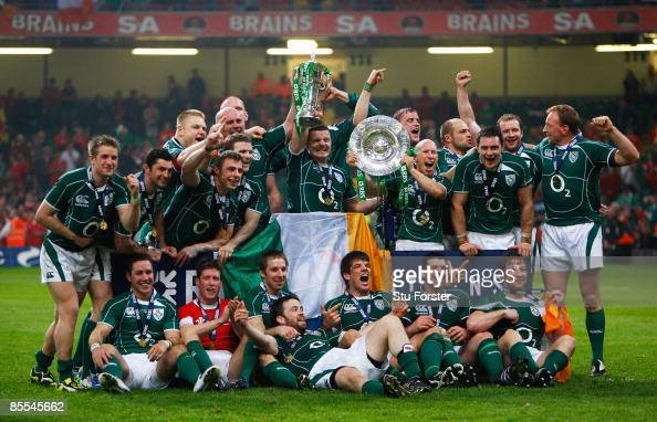 The Irish team celebrate winning the Grand Slam after the RBS 6 Nations Championship match between Wales and Ireland at the Millennium Stadium on...