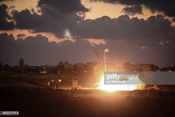 The Iron Dome airdefense system fires to intercept a rocket over the city of Ashdod on July 16 2014 in AshdodIsrael An Egyptian ceasefire proposal...