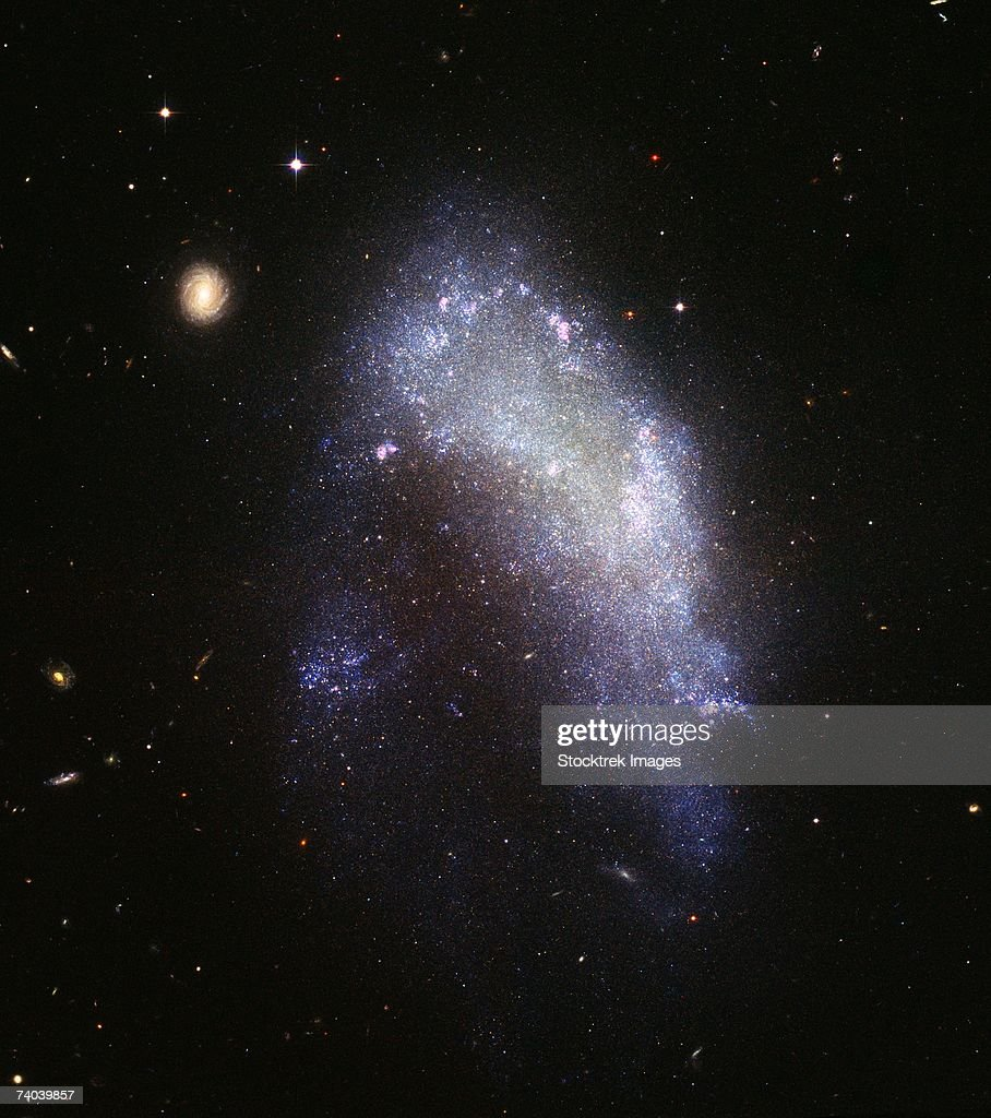 The irregular galaxy NGC 1427A is a spectacular example of the resulting stellar rumble.