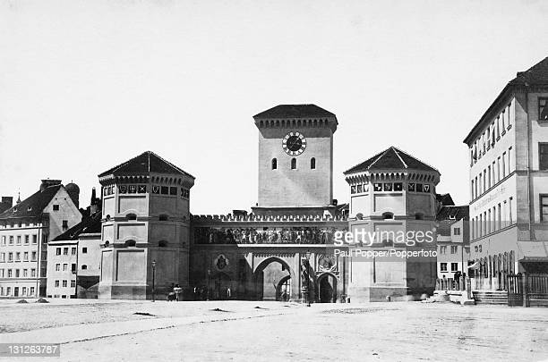 The Isartor a medieval city gate in east Munich Germany circa 1900