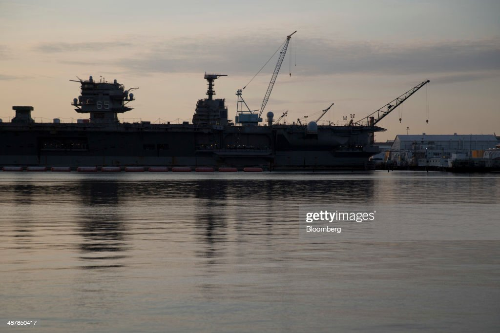 The island towers of the USS Enterprise left and USS Gerald R Ford center aircraft carriers are seen as they float pier side at Huntington Ingalls...