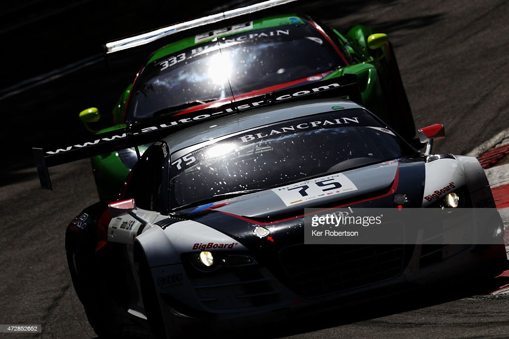 The ISR Audi R8 LMS Ultra of Marco Bonanomi and Filip Salaquadra leads from the Rinaldi Racing Ferrari 458 Italia of Marco Seefried and Norbert...