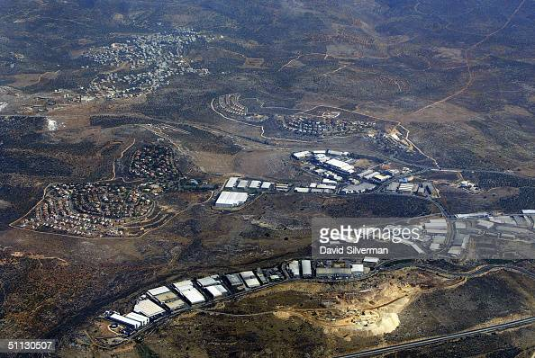 The Israeli settlements of Barkan and Kiryat Netafim separate the Palestinian village of khirbet Bani Hassan July 30 2004 from the of the West Bank...