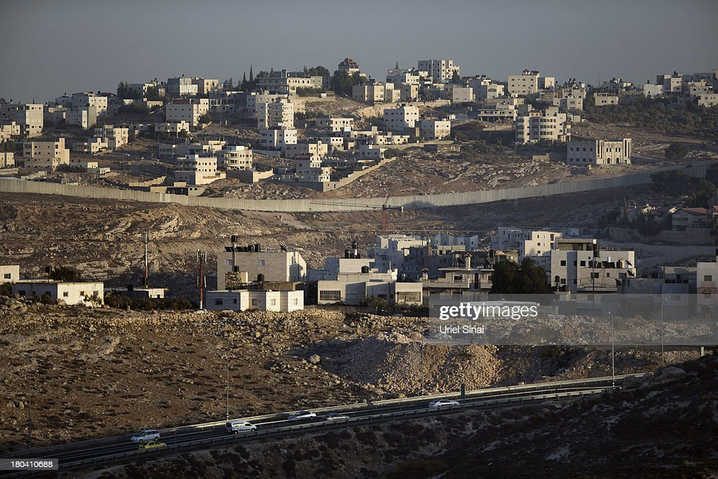The Israeli West Bank barrier separates Jewish and Palestinian neighborhoods on September 12, 2013 on the outskirts of Jerusalem, West Bank. The twenty-year anniversary of the Oslo Accord, which was to set up a framework for peace between Israel and Palestine, will be marked on September 13.