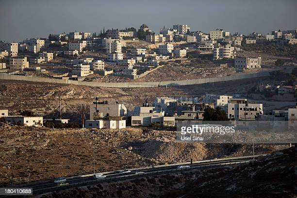 The Israeli West Bank barrier separates Jewish and Palestinian neighborhoods on September 12 2013 on the outskirts of Jerusalem West Bank The...