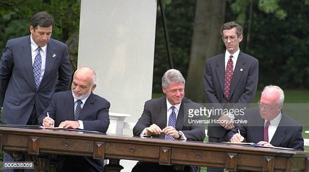 The Israel–Jordan peace treaty being signed in 1994 US President Bill Clinton watches Jordan's King Hussein and Israeli Prime Minister Yitzhak Rabin...