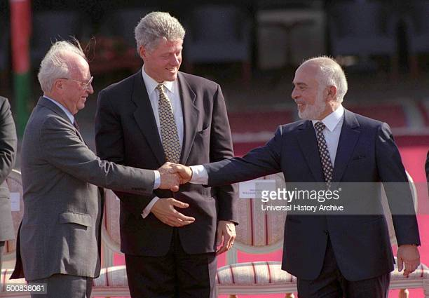 The Israel–Jordan peace treaty being signed in 1994 US President Bill Clinton watches Jordan's King Hussein and Israeli Prime Minister Yitzhak Rabin...