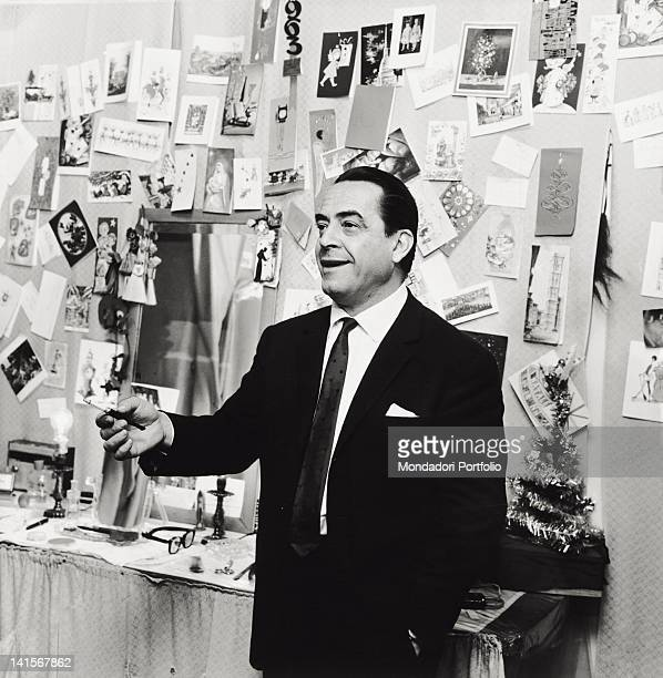 The Italian actor Carlo Dapporto smoking a cigarette in his dressing room after the debut in 'Babilonia' Milan January 1963