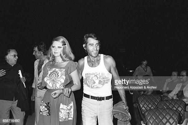 The Italian actor comician and host Walter Chiari walking arm in arm with the actress Sylva Koscina inside a theatre during rehearsal of a show...