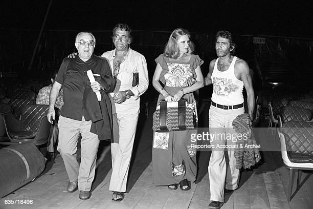 The Italian actor comician and TV host Walter Chiari and the actors Sylva Koscina Alberto Lupo and Carlo Campanini walking inside a theatre during...