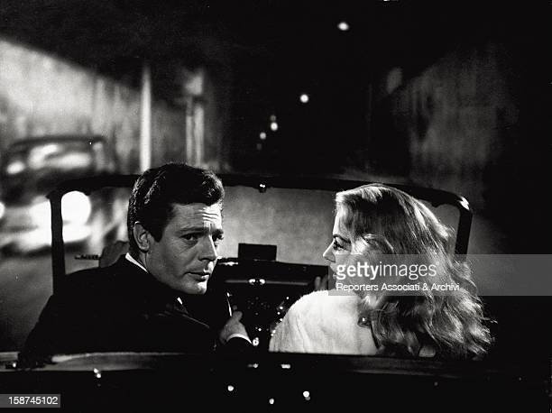 The Italian actor Marcello Mastroianni driving a car with the Swedish actress Anita Ekberg in the film La dolce vita Rome 1960