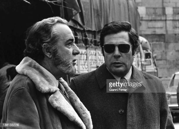The Italian actor Marcello Mastroianni together with the Spanish actor Fernando Rey in a rest of the filming of the movie ' The femme aux bottes...