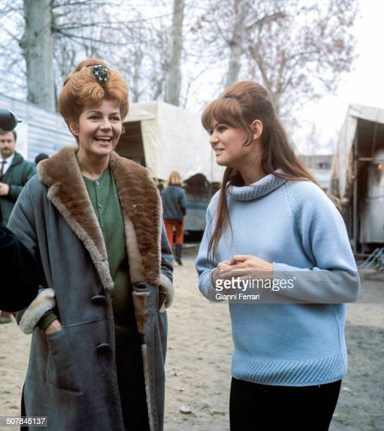 The Italian actress Claudia Cardinale and the American actress Rita Hayworth during a break from shooting the movie 'Circus World' Madrid Spain