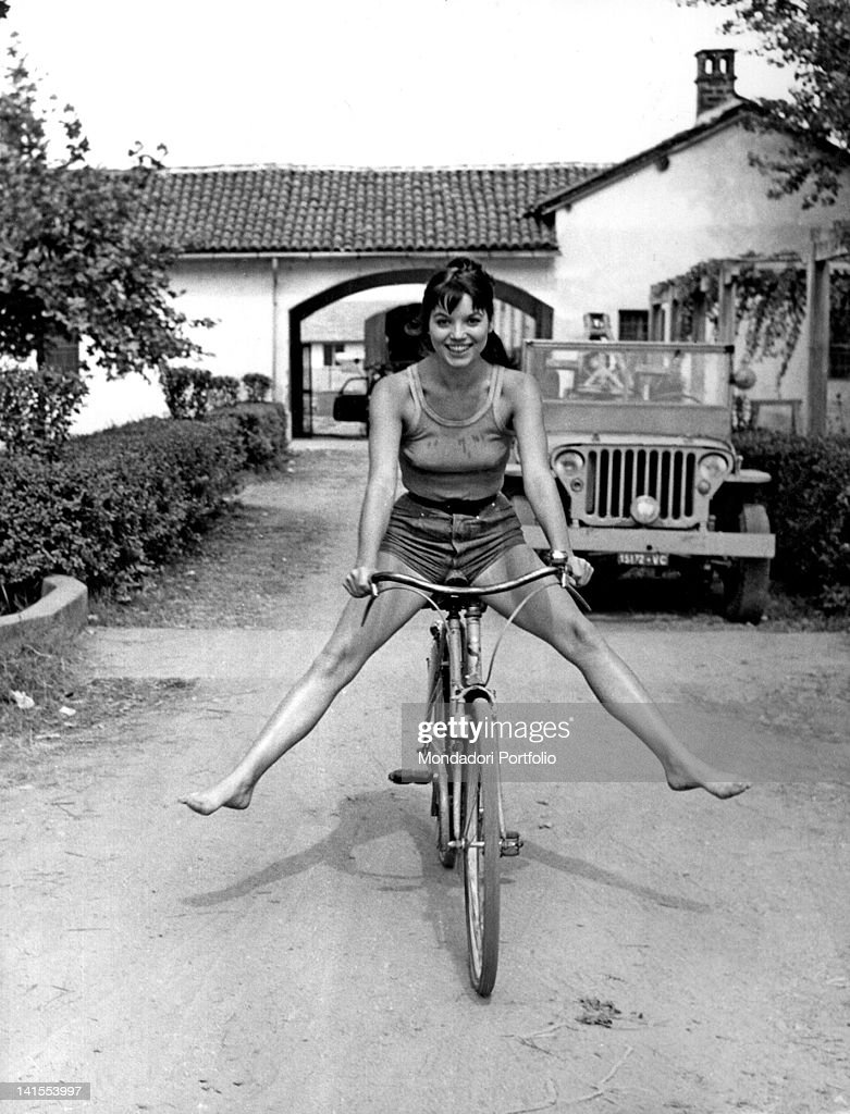 The Italian actress Elsa Martinelli riding a bicycle during the shooting of the movie 'La risaia' at the farm called 'La Graziosa' Casalino August...