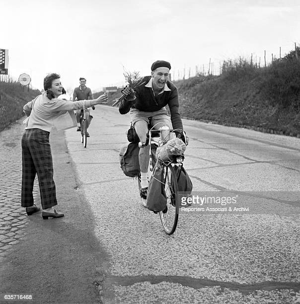 The Italian actress Marisa Allasio acting as patron of the road cycle race RomeNaplesRome offering a bunch of flowers to one of the competitors Italy...