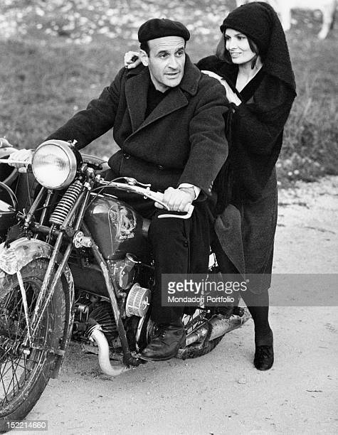 The Italian actress Scilla Gabel and the Italian actor Pier Paolo Capponi posing on a Guzzi motorcycle on the set of the TV serial 'Vino e Pane'...