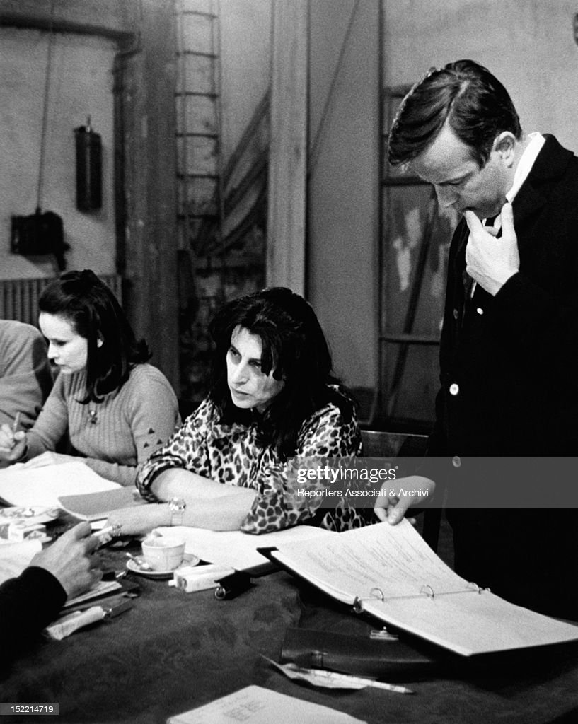 The Italian actresses Anna Maria Guarnieri and Anna Magnani and the Italian director Franco Zeffirelli studying the script of 'La Lupa' 1965