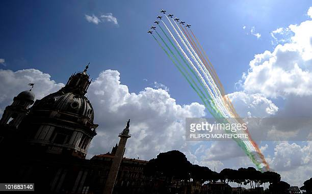 The Italian Air Force aerobatic unit Frecce Tricolori spread green white and red smoke to recall the colours of the Italian flag over central Rome's...
