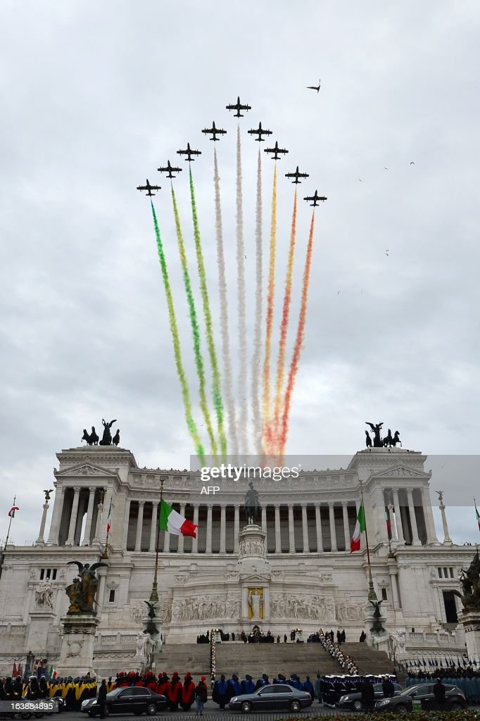 The Italian Air Force aerobatic unit Frecce Tricolori (Tricolor Arrows) spreads smoke with the colors of the Italian flag over the Piazza Venezia to celebrate the 152th anniversary of Italian national unification on March 17, 2013 in Rome.