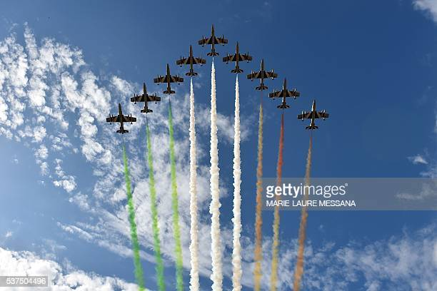 The Italian Air Force aerobatic unit Frecce Tricolori spreads smoke with the colors of the Italian flag over the Piazza Venezia on June 2 2016 as...