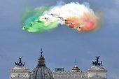 The Italian Air Force aerobatic unit Frecce Tricolori spreads smoke with the colors of the Italian flag over the city of Rome on June 2 2016 as part...