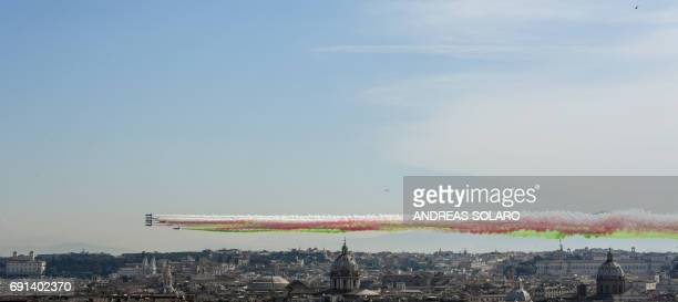 The Italian Air Force aerobatic unit Frecce Tricolori spreads smoke with the colors of the Italian flag over the city of Rome on June 2 2017 as part...