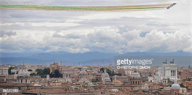The Italian Air Force aerobatic unit Frecce Tricolori spreads smoke with the colors of the Italian flag over Rome on June 2 2009 during celebrations...