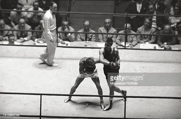 The Italian boxer Nino Benvenuti defeating Soviet boxer Yuri Radonyak the final of the welterweight boxing tournament Rome 1960