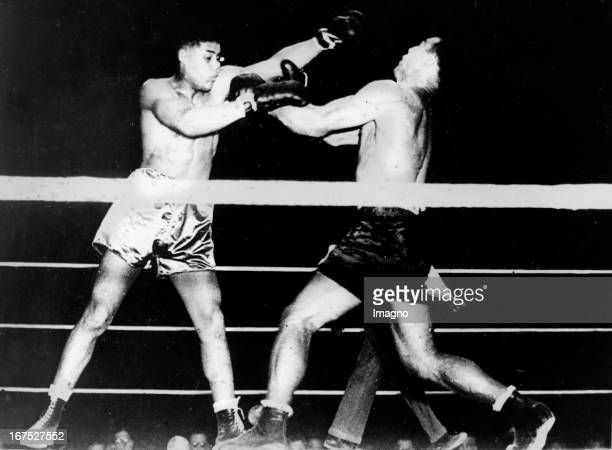 The Italian Boxer Primo Carnera in his fight with the American boxer and world heavyweight champion Joe Louis known as The Brown Bomber endet with a...