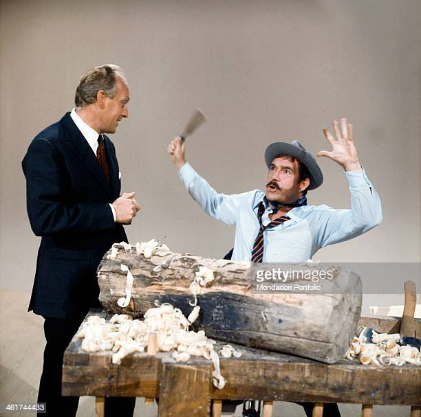 The Italian comedians Ugo Tognazzi and Raimondo Vianello in a comic sketch in the TV show Un due tre directed by Mario Landi on the newborn RAI TV...