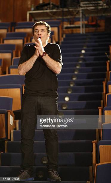 The Italian comic actor Gioele Dix standing in the empty stalls of the Verona Teatro Camploy directs the actors on stage during the rehearsal of A...