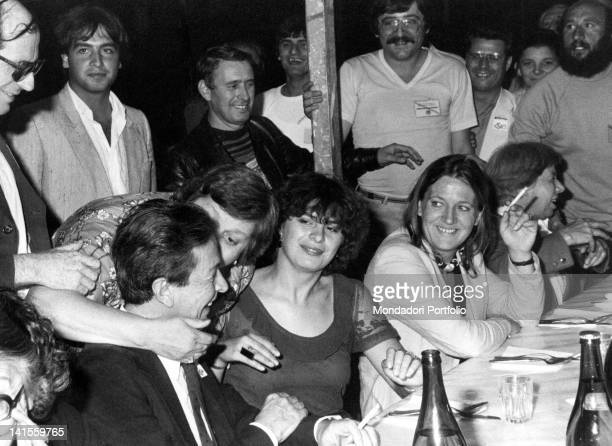 The Italian Communist Party General Secretary Enrico Berlinguer joking around with some militants during the Festa dell'Unita Venice 19th July 1981