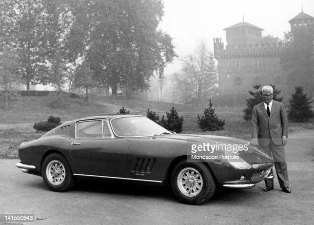 The Italian designer Battista Pinin Farina observing a Ferrari car designed by him in the park of the Castello del Valentino Turin 1960s