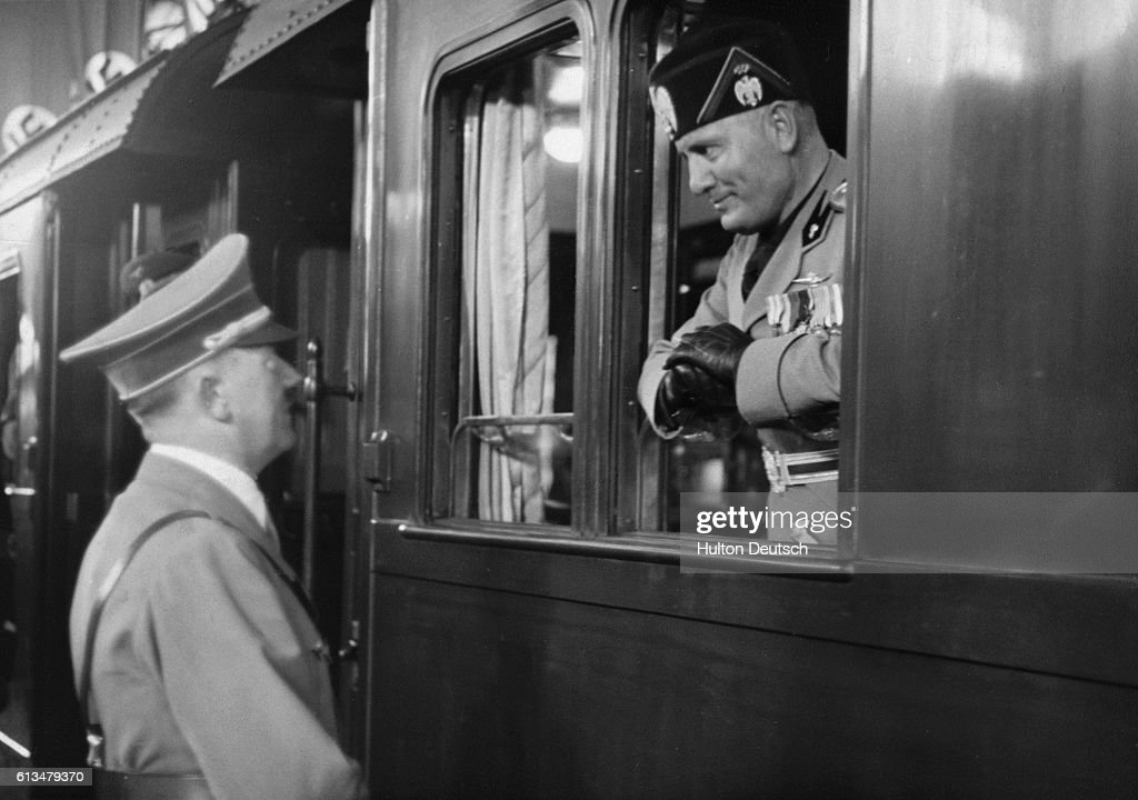 The Italian dictator Benito Mussolini is seen off in his armoured train from Berlin, by his German counterpart Adolf Hitler at the end of his 1937.