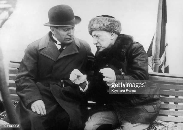 The Italian dictator Benito MUSSOLINI speaking with the Italian writer and poet Gabriele d'ANNUNZIO in Gardone di Riviera Italy in 1925