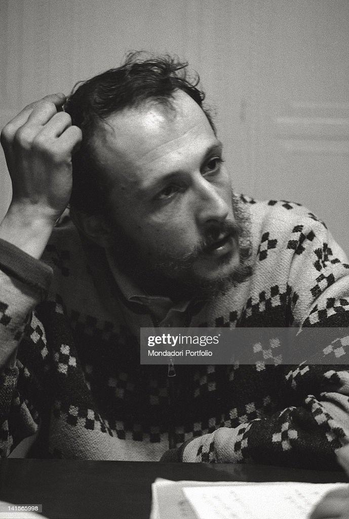 The Italian director of 'Mondo Beat' magazine Melchiorre Gerbino posing sitting at the table. Milan, 1960s