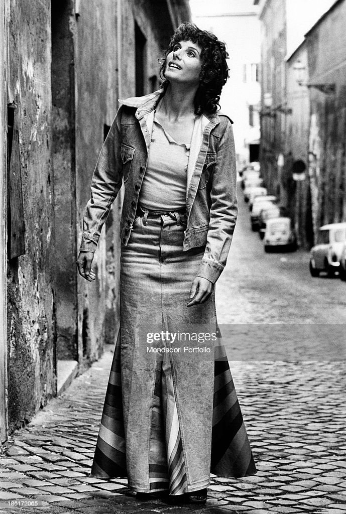 The Italian film theatre and television actress Paola Pitagora is posing in front of the photographer and wearing an eccentric denim skirt and shirt...