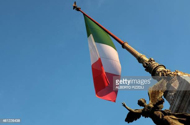 The Italian flag flies at half mast at the monument to the Unkown Soldier in Rome on January 9 in homage to the victims of an attack by armed gunmen...