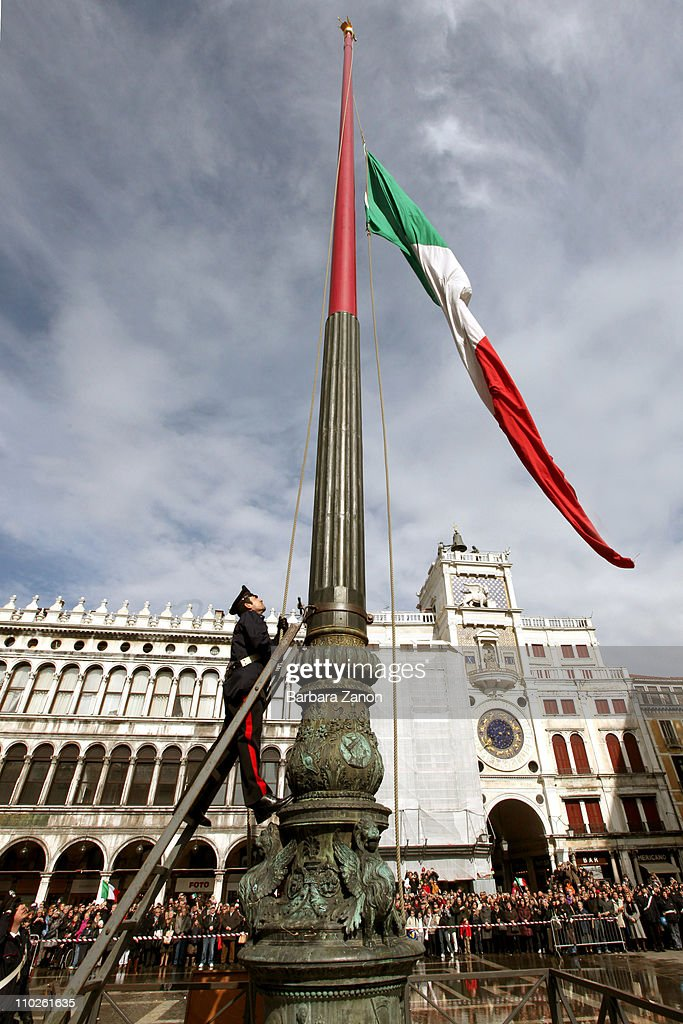 The Italian flag is raised as citizens celebrate the 150th anniversary of Italy's unification in the Piazza San Marco on March 17, 2011 in Venice, Italy. Events to celebrate the 150th anniversary of Italy's unification are planned in various cities across Italy until the end of the year.