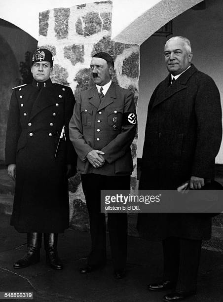 The Italian Foreign Minister Galeazzo Ciano with Adolf Hitler in front of the Berghof on the Obersalzberg near Berchtesgaden on the right Reich...