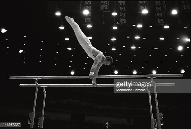 The Italian gymnast Franco Menichelli training on the parallel bars during Mexico City Olympics Mexico City October 1968