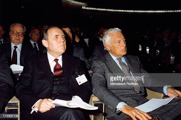The Italian industrialist and Fiat owner Gianni Agnelli and the governor of the Bank of Italy Carlo Azeglio Ciampi listen attentively while seated in...