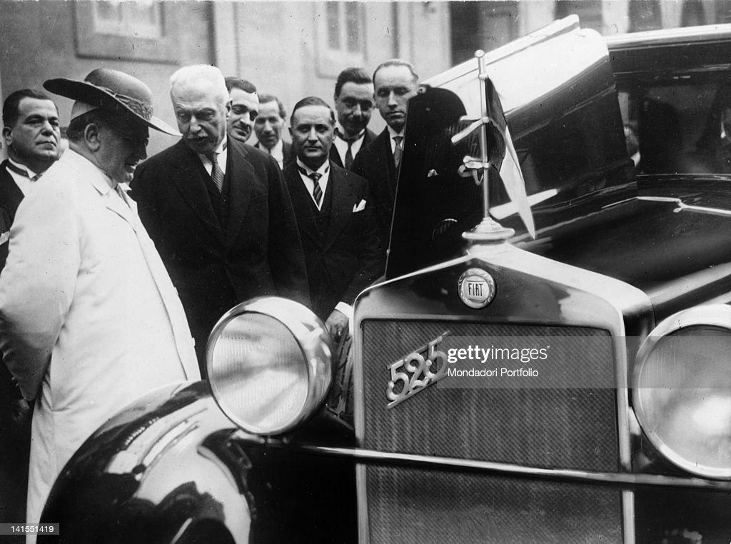 The Italian industrialist and founder of the 'Fiat' car manufacturer meeting Pope Pius IX on the presentation of the new 'Fiat 525' car. Vatican City, 1929